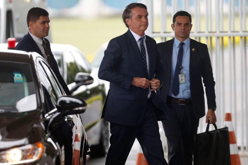 Brazil's President Jair Bolsonaro walks as he leaves the Alvorada Palace in Brasilia