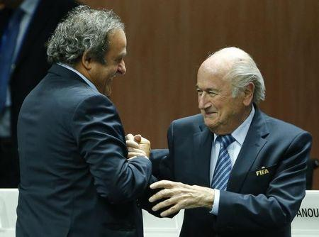 UEFA President Platini congratulates FIFA President Blatter after he was re-elected at the 65th FIFA Congress in Zurich
