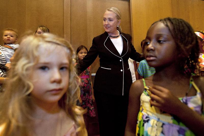 Secretary of State Hillary Rodham Clinton greets children of during a visit with U.S. Embassy staff in Dakar, Senegal, Wednesday, Aug. 1, 2012. (AP Photo/Jacquelyn Martin, Pool)