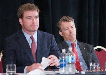 Jack Conway and Ron Paul appear at an event in July.