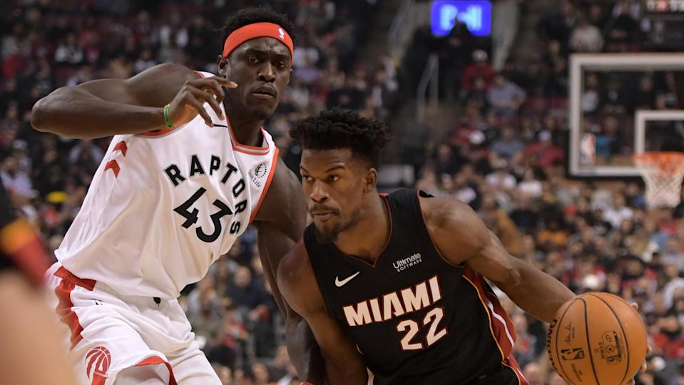 Dec 3, 2019; Toronto, Ontario, CAN;  Miami Heat forward Jimmy Butler (22) drives to the basket as Toronto Raptors forward Pascal Siakam (43) defends in the first half at Scotiabank Arena. Mandatory Credit: Dan Hamilton-USA TODAY Sports