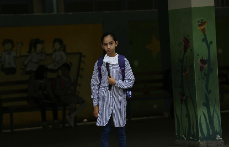 A student walks to class on the first day of the new school year at the United-Nation run Elementary School at the Shati refugee camp in Gaza City, Saturday, Aug. 8, 2020. Schools run by both Palestinian government and the U.N. Refugee and Works Agency (UNRWA) have opened almost normally in the Gaza Strip after five months in which no cases of community transmission of the coronavirus had been recorded. (AP Photo/Adel Hana)