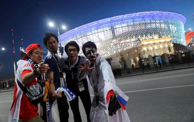Soccer Football - World Cup - Group H - Japan v Senegal - Ekaterinburg Arena, Yekaterinburg, Russia - June 24, 2018. Fans of Japan pose outside the stadium after the match. REUTERS/Marcos Brindicci
