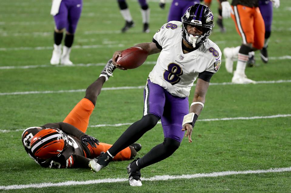 CLEVELAND, OHIO - DECEMBER 14: Lamar Jackson #8 of the Baltimore Ravens scores a touchdown during the second quarter in the game against the Cleveland Browns at FirstEnergy Stadium on December 14, 2020 in Cleveland, Ohio. (Photo by Gregory Shamus/Getty Images)