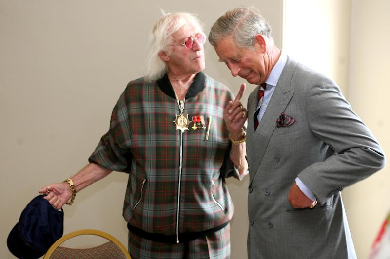 Prince Charles meets Sir Jimmy Savile during his visit to Scarborough. (Photo by Gareth Copley - PA Images/PA Images via Getty Images)