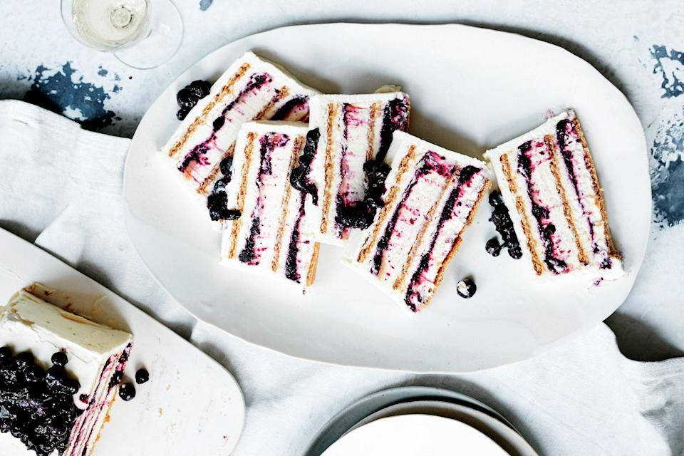 "The more particular you are when building the layers in the loaf pan, the more neat and tidy this will look when sliced. But if it's a little uneven and the layers blend together, so be it! <a href=""https://www.epicurious.com/recipes/food/views/blueberry-lemon-icebox-cake?mbid=synd_yahoo_rss"" rel=""nofollow noopener"" target=""_blank"" data-ylk=""slk:See recipe."" class=""link rapid-noclick-resp"">See recipe.</a>"