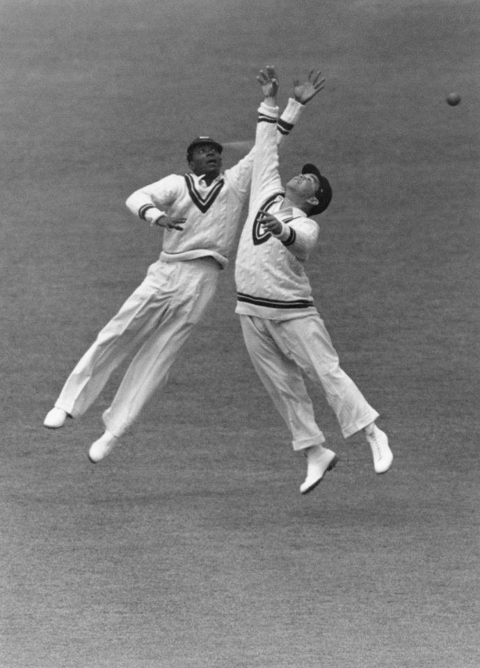 Two West Indies fielders jump for a ball from Fishlock, in the slips during a match against Surrey at the Oval, London, 22nd May 1939. (Photo by Central Press/Hulton Archive/Getty Images)