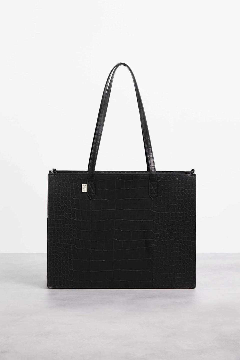 """<p><strong>Béis</strong></p><p>beistravel.com</p><p><strong>$108.00</strong></p><p><a href=""""https://beistravel.com/collections/all-products/products/the-mini-work-tote-in-black-croc"""" rel=""""nofollow noopener"""" target=""""_blank"""" data-ylk=""""slk:Shop Now"""" class=""""link rapid-noclick-resp"""">Shop Now</a></p><p>A new work tote for their new office. May they never find a work wife as cool as you (heh). </p>"""