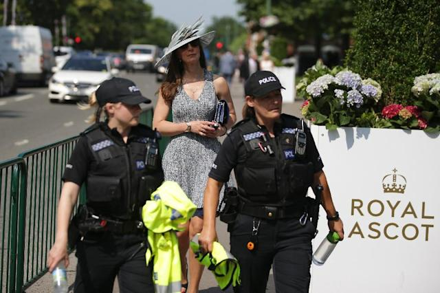 Breathalysers and sniffer dogs to root out those carrying illegal substances are to be introduced at the glamorous Royal Ascot race carnival next week as measures to prevent a repeat of ugly brawls at racecourses in May (AFP Photo/Daniel LEAL-OLIVAS)