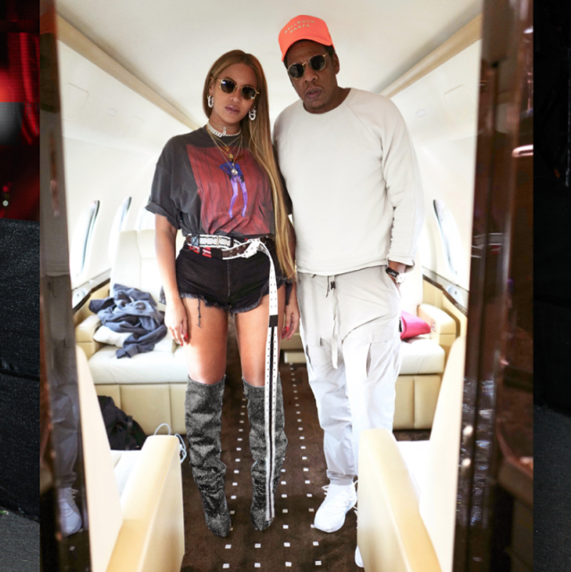 Beyoncé wears the Saint Laurent sparkle boots alongside Jay-Z. (Photo: Instagram)