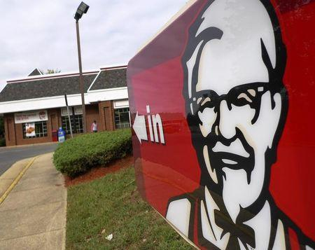 A Kentucky Fried Chicken sign shows the direction to its restaurant in Fairfax