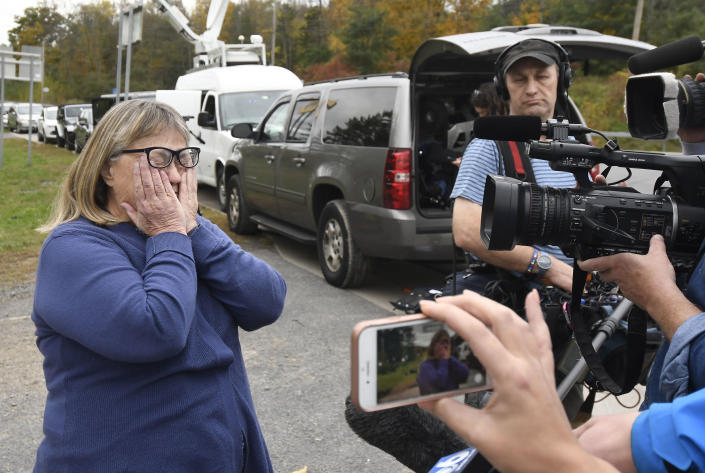 Barbara Douglas of Danamora, N.Y., reacts while talking about her four family members who died in Saturday's fatal crash in Schoharie, N.Y., Sunday, Oct. 7, 2018. A limousine loaded with revelers headed to a 30th birthday party blew a stop sign at the end of a highway and slammed into an SUV parked outside a store, killing all people in the limo and a few pedestrians, officials and relatives of the victims said Sunday. (AP Photo/Hans Pennink)