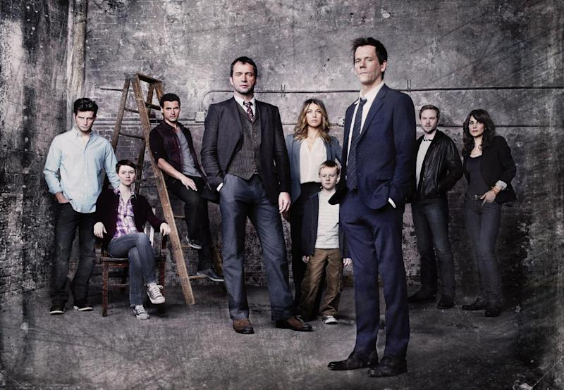 """This undated publicity photo released by FOX shows Kevin Bacon, front right, as former FBI agent Ryan Hardy, who is called out of retirement to track down James Purefoy, (fourth from left) as Joe Carroll, in the new psychological thriller """"The Following,"""" premiering Monday, Jan. 21, 2013,  (9:00-10:00 PM ET/PT) on FOX.  From rear left, cast members, Nico Tortorella, Valorie Curry, Adan Canto, Natalie Zea, Kyle Catlett, Shawn Ashmore and Annie Parisse. Fox's entertainment chief, Kevin Reilly, said Tuesday, Jan. 8, 2013, that the network did not change the content or promotion of """"The Following,"""" its upcoming drama about a serial killer, because of the Connecticut school shooting or other real-life acts of violence. (AP Photo/FOX, Michael Lavine)"""