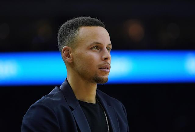 Warriors fans won't have to see Stephen Curry in a suit much longer. (Getty)