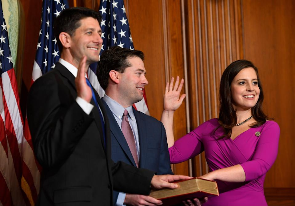 Rep. Elise Stefanik, R-N.Y. stands with Matthew Manda and House Speaker Paul Ryan, R-Wis., for a ceremonial swearing-in and photo-op during the opening session of the 115th Congress on Jan. 3, 2017, on Capitol Hill in Washington.