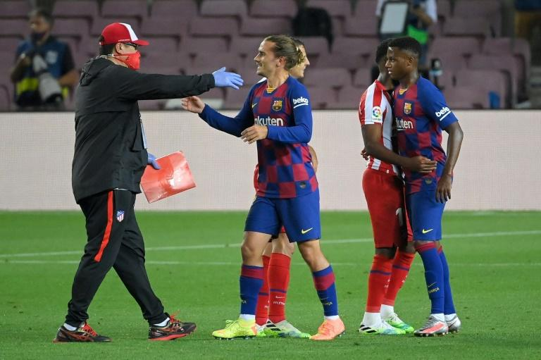 Barcelona striker Antoine Griezmann greets an Atletico Madrid staff member after Tuesday's 2-2 draw at the Camp Nou. The Frenchman spent most of the game against his old club on the bench