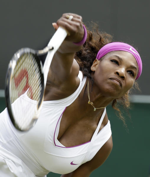 Serena Williams of the United States returns a shot to Barbora Zahlavova Strycova of the Czech Republic during a first round women's singles match at the All England Lawn Tennis Championships at Wimbledon, England, Tuesday, June 26, 2012. (AP Photo/Alastair Grant)