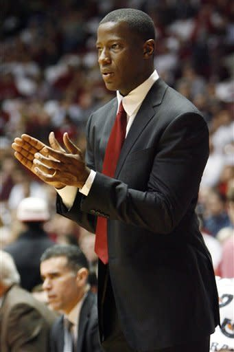 Alabama coach Anthony Grant cheers on his team against Florida in the first half of an NCAA college basketball game in Tuscaloosa, Ala., Tuesday, Feb. 14, 2012. (AP Photo/Robert Sutton)