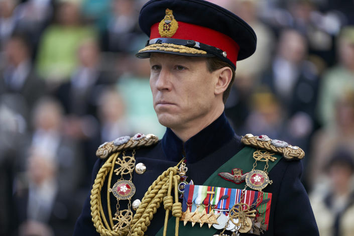 "In this image released by Netflix, Tobias Menzies portrays Prince Philip in a scene from the third season of ""The Crown."" Britain's Prince Philip stood loyally behind behind Queen Elizabeth, as his character does on Netflix's ""The Crown."" But how closely does the TV character match the real prince, who died Friday, April 9, 2021 at 99? Philip is depicted as a man of action in ""The Crown,"" and he served with distinction in the navy in World War II. He was also an avid yachtsman and polo player. (Des Willie/Netflix via AP)"