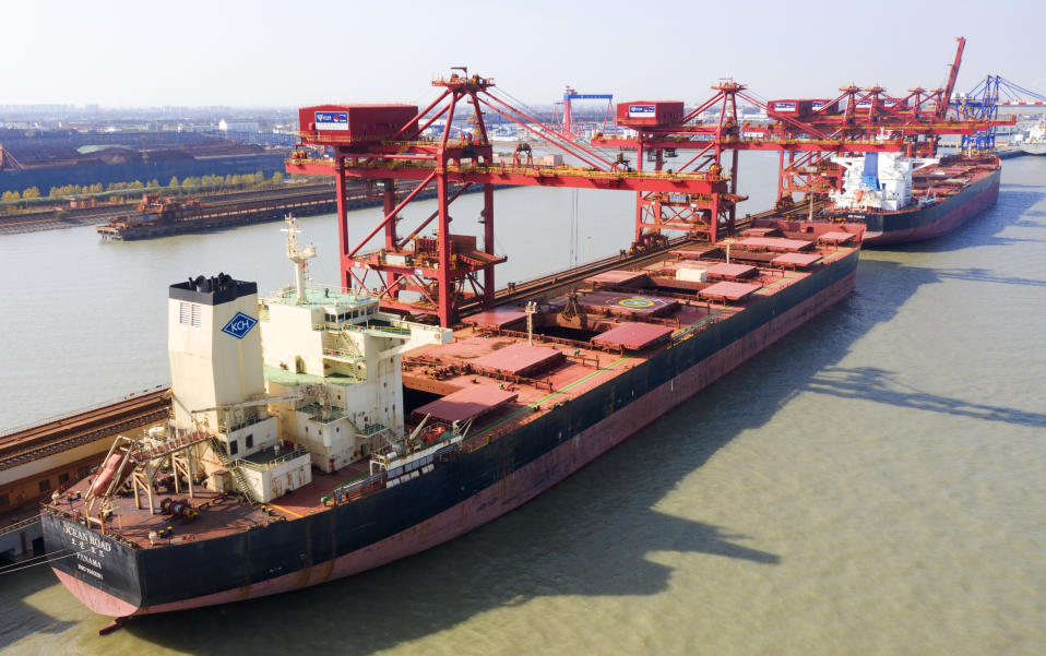 SUZHOU, CHINA - DECEMBER 9, 2020 - Aerial photo taken on December 9, 2020 shows a ship unloader unloading iron ore imported from Australia at an iron ore operation terminal in Taicang Port in Suzhou, East China's Jiangsu Province, China.- PHOTOGRAPH BY Costfoto / Barcroft Studios / Future Publishing (Photo credit should read Costfoto/Barcroft Media via Getty Images)