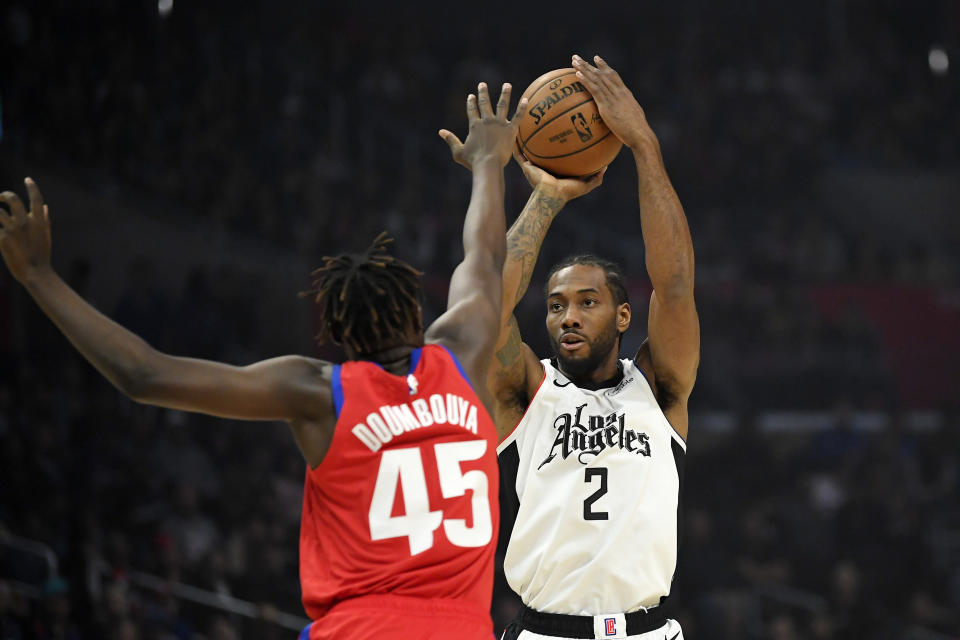 Los Angeles Clippers forward Kawhi Leonard, right, shoots as Detroit Pistons forward Sekou Doumbouya defends during the first half of an NBA basketball game Thursday, Jan. 2, 2020, in Los Angeles. (AP Photo/Mark J. Terrill)