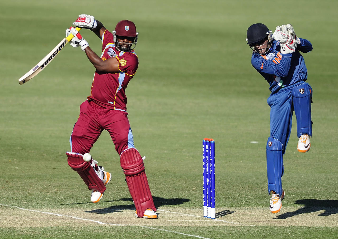 TOWNSVILLE, AUSTRALIA - AUGUST 12:  Kyle Mayers of the West Indies bats in front of Smit Patel of India during the ICC U19 Cricket World Cup 2012 match between the West Indies and India at Tony Ireland Stadium on August 12, 2012 in Townsville, Australia.  (Photo by Ian Hitchcock-ICC/Getty Images)