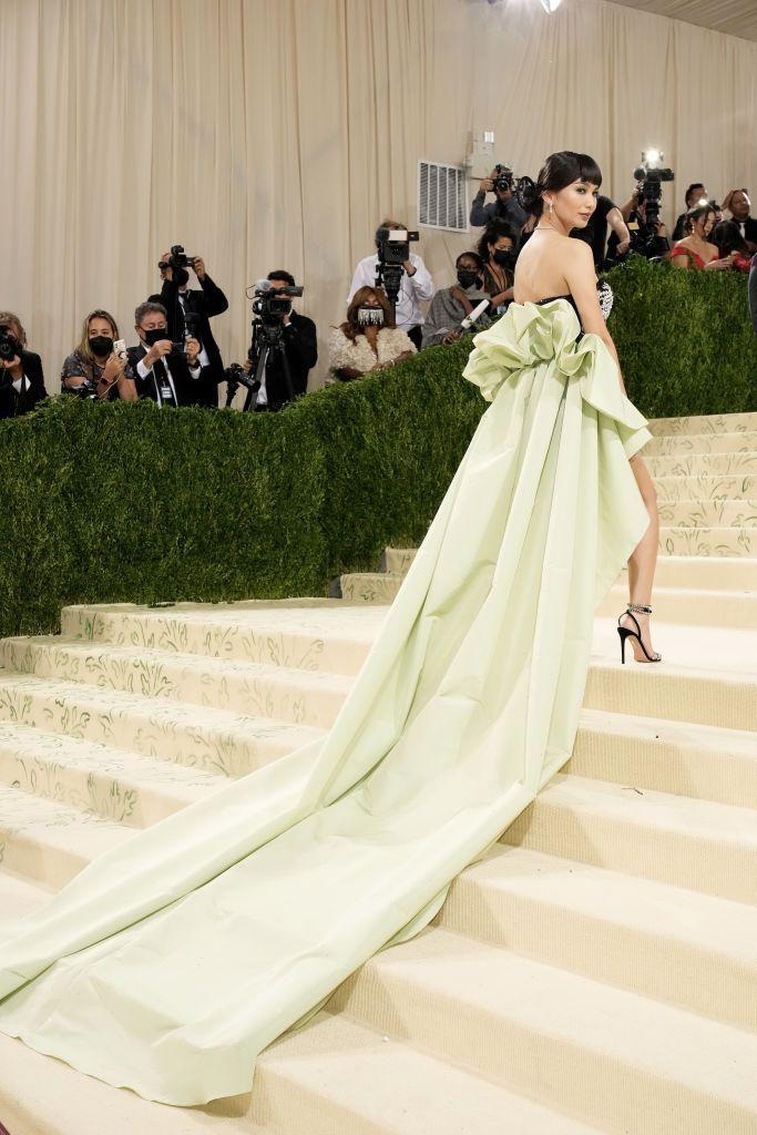 """<p>British actress Gemma Chan pulled out all the stops with her embellished Prabal Gurung mini dress, which featured a dramatic mint-green train. The dress was a tribute to Anna May Wong, the first Chinese-American film star of Hollywood's golden era. """"A trailblazer, fashion icon and woman ahead of her time – she paved the way for those who came after and continues to inspire,"""" Chan wrote.</p>"""