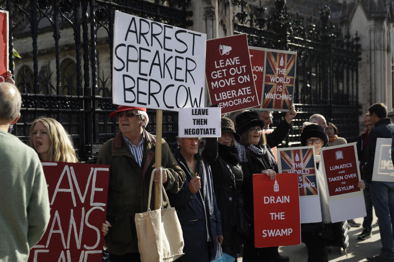 Brexit leave the European Union supporters protest with placards outside the Houses of Parliament in London, Tuesday, Oct. 22, 2019. British Prime Minister Boris Johnson's European Union divorce bill faces two votes Tuesday, with lawmakers first being asked to approve it in principle, followed by a vote on the government's schedule for debate and possible amendments. (AP Photo/Matt Dunham)
