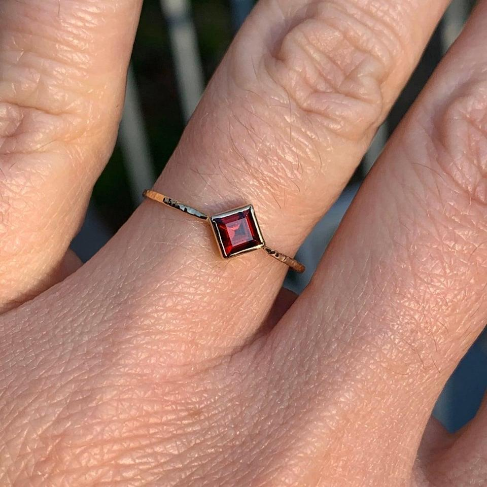 """<h2>Mary John Handmade Gold Garnet Ring<br></h2><br>If you're working with a generous budget this year, we suggest making a beeline for North Carolina-based Mary John Slaughter's Etsy shop. The designer's delicate, handmade fine jewelry is perfect for stacking and layering along with any heirlooms that your mom already cherishes — and the organic motifs will jive with her boho-mom style.<br><br><em>Shop <strong><a href=""""https://www.etsy.com/shop/MARYJOHN"""" rel=""""nofollow noopener"""" target=""""_blank"""" data-ylk=""""slk:Mary John"""" class=""""link rapid-noclick-resp"""">Mary John</a></strong></em> <em>on Etsy</em><br><br><strong>Mary John</strong> Solid Gold Step-Cut Garnet Ring, $, available at <a href=""""https://go.skimresources.com/?id=30283X879131&url=https%3A%2F%2Fwww.etsy.com%2Flisting%2F771068814%2Fscarlet-red-garnet-ring-solid-gold"""" rel=""""nofollow noopener"""" target=""""_blank"""" data-ylk=""""slk:Etsy"""" class=""""link rapid-noclick-resp"""">Etsy</a>"""