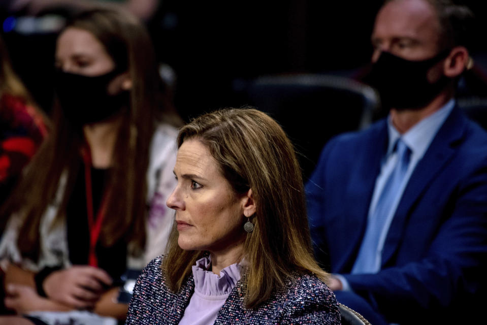 Supreme Court nominee Amy Coney Barrett listens during a confirmation hearing before the Senate Judiciary Committee, Wednesday, Oct. 14, 2020, on Capitol Hill in Washington. (Hilary Swift/The New York Times via AP, Pool)