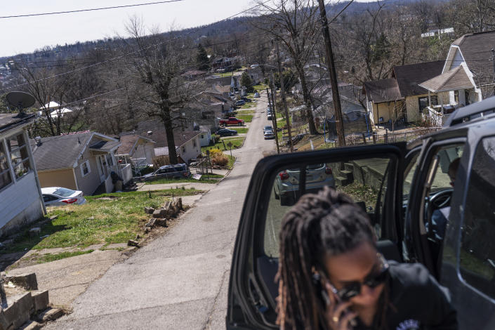 Larrecsa Cox, who leads the Quick Response Team that tries to track down everyone who overdoses to offer help, arrives in a neighborhood to visit a client who recently overdosed in Huntington, W.Va., Friday, March 19, 2021. The team was born amid a horrific crescendo of America's addiction epidemic: On the afternoon of August 15, 2016, 28 people overdosed in four hours in Huntington. Almost everyone who overdosed that afternoon was saved, but no one was offered help navigating the bewildering treatment system. One of them, a 21-year-old woman, overdosed again 41 days later. That time she died. (AP Photo/David Goldman)