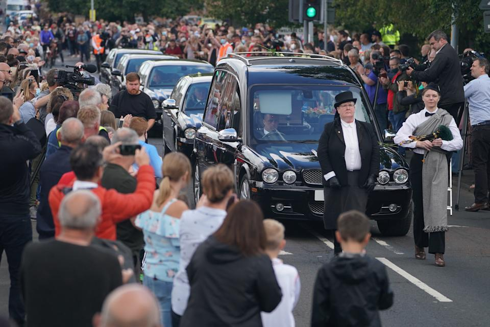 People line the streets as the funeral cortege of Jack Charlton passes through his hometown of Ashington, in Northumberland ahead of his funeral service at West Road Crematorium, in Newcastle. The former Republic of Ireland manager, who won the World Cup, playing for England, died on July 10 aged 85.
