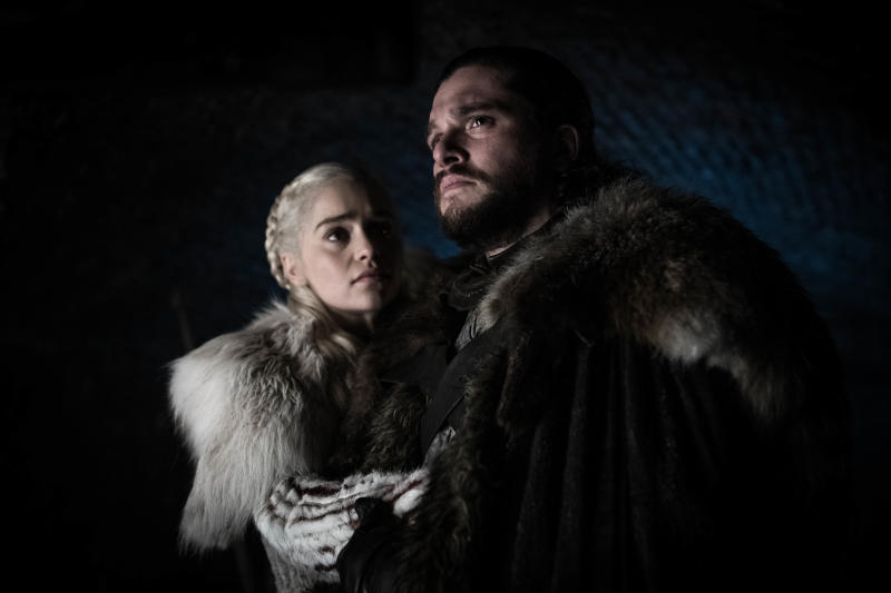 "This image released by HBO shows Emilia Clarke and Kit Harington in a scene from ""Game of Thrones,"" that aired Sunday, April 21, 2019. With the Game of Thrones' Jon Snow revealing his royal lineage to his potential rival Daenerys Targaryen, the beleaguered army at Winterfell is about to find out if two chief executives better than one. (Helen Sloan/HBO via AP)"