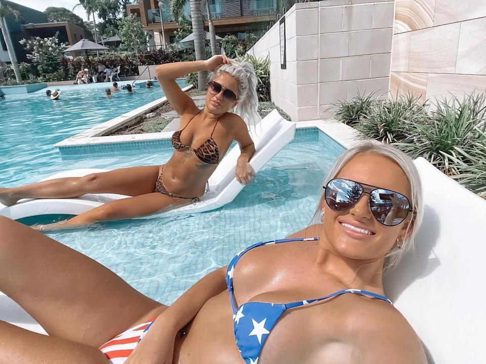 Jessica posed for a snap with a friend while wearing the American flag swimmers. Photo: Instagram/kassy_riviero.