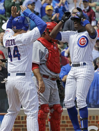Chicago Cubs' Alfonso Soriano, right, celebrates with Anthony Rizzo after hitting a two-run home run during the first inning of a baseball game against the Cincinnati Reds in Chicago, Saturday, May 4, 2013. (AP Photo/Nam Y. Huh)