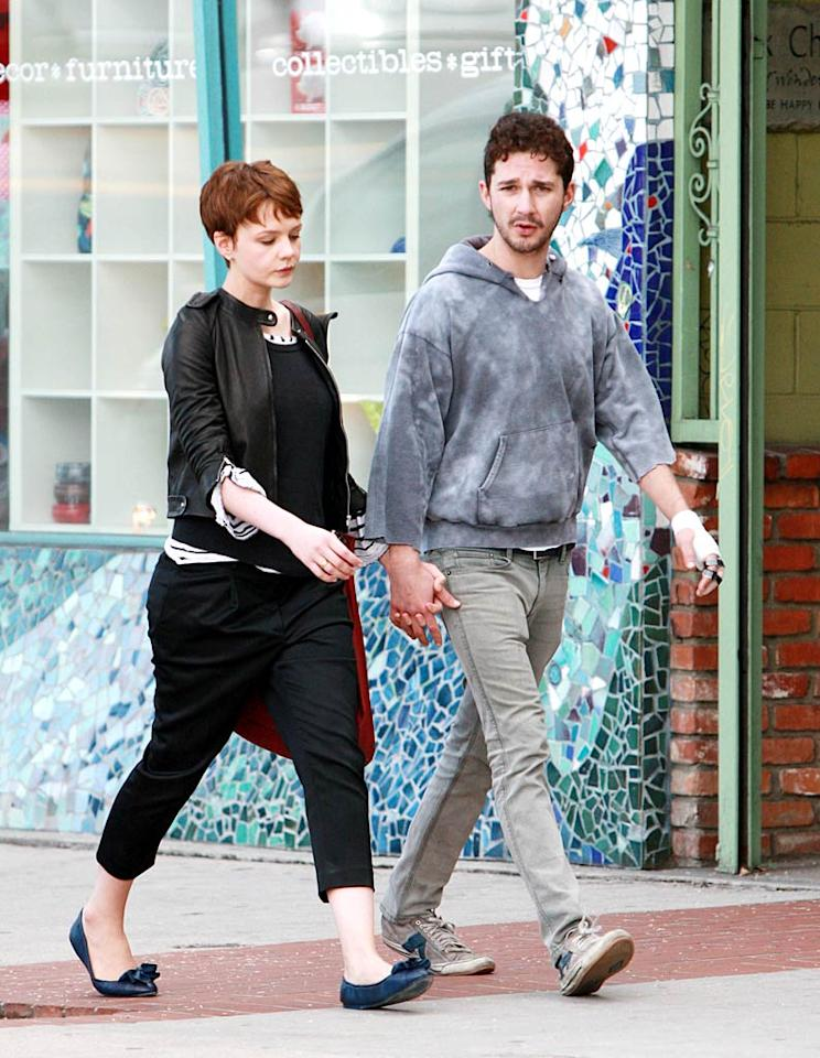 """Golden Globe nominee Carey Mulligan (""""An Education"""") and bad boy beau Shia LaBeouf spend an afternoon strolling hand-in-hand through Sherman Oaks, California, stopping at Baja Fresh and Borders bookstore. <a href=""""http://www.splashnewsonline.com"""" target=""""new"""">Splash News</a> - December 15, 2009"""