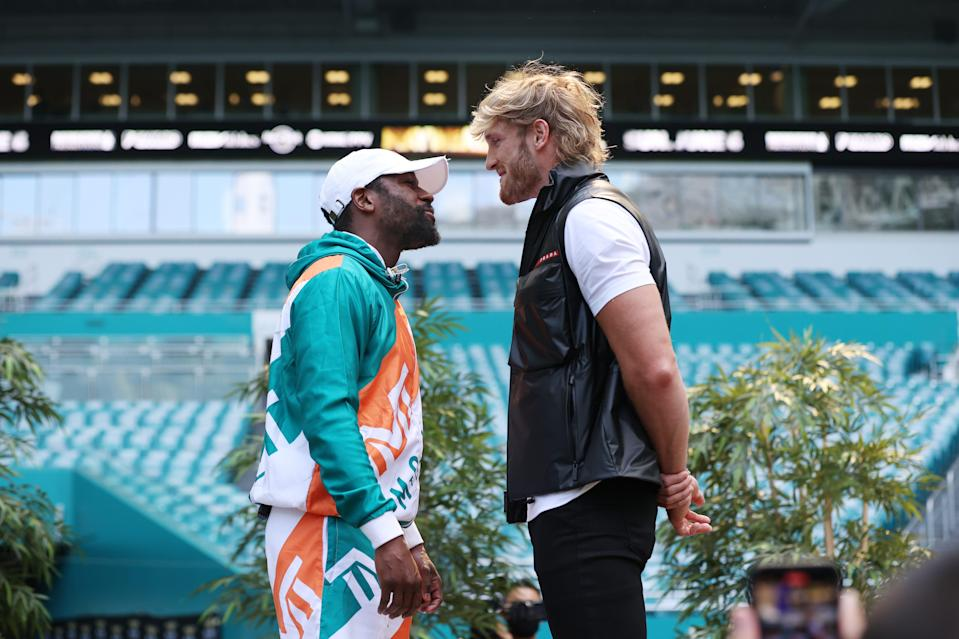 Floyd Mayweather and Logan Paul face off during media availability prior to their June 6 match.