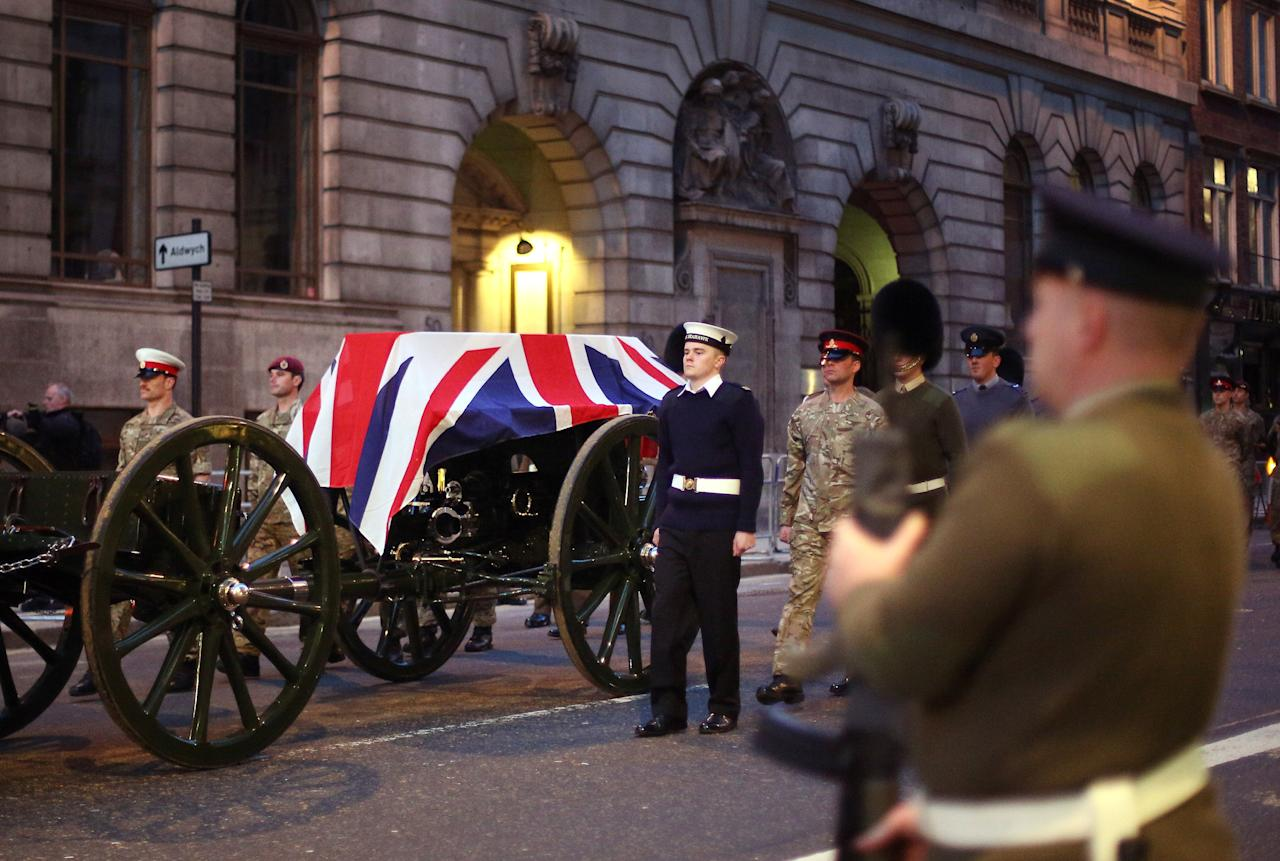 LONDON, ENGLAND - APRIL 15:  A flag draped coffin is carried on a gun carriage during a rehearsal for the ceremonial funeral of former Prime Minister Margaret Thatcher on the steps of St Paul's Cathedral on April 15, 2013 in London, England. Lady Thatcher's coffin will be carried on a gun carriage though the City of London to St Paul's cathedral where a funeral service will be held on April 17.  (Photo by Peter Macdiarmid/Getty Images)