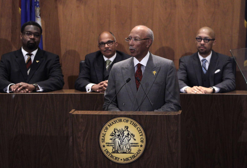 Detroit Mayor Dave Bing lays out his plans and highlights accomplishments in his third State of the City address in Detroit, Wednesday, March 7, 2012. In the background are Detroit City Council members from left, James Tate, Gary Brown, and President Charles Pugh. (AP Photo/Carlos Osorio)