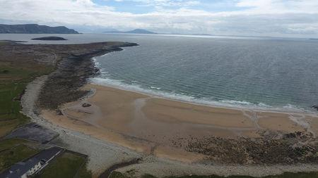Dooagh beach is seen after a storm returned sand to it, 30 years after another storm had stripped all the sand off the beach, on Achill island, County Mayo