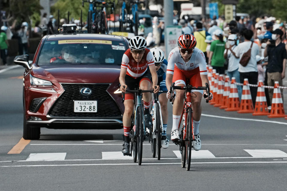 Anna Plichta of Poland front, Anna Kiesenhofer of Austria center, and Omer Shapira of Israel, lead in a three-rider breakaway during the women's cycling road race at the 2020 Summer Olympics, Sunday, July 25, 2021, in Oyama, Japan. (AP Photo/Thibault Camus)