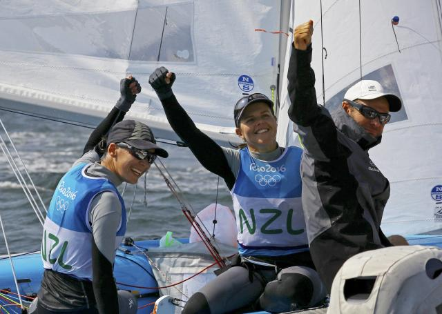 2016 Rio Olympics - Sailing - Final - Women's Two Person Dinghy - 470 - Medal Race - Marina de Gloria - Rio de Janeiro, Brazil - 18/08/2016. Jo Aleh (NZL) of New Zealand and Polly Powrie (NZL) of New Zealand celebrate silver medal. REUTERS/Brian Snyder FOR EDITORIAL USE ONLY. NOT FOR SALE FOR MARKETING OR ADVERTISING CAMPAIGNS.