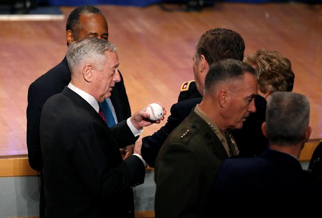 U.S. Secretary of Defense James Mattis signs a baseball for a guest before U.S. President Donald Trump delivers remarks regarding the Administration's National Security Strategy at the Ronald Reagan Building and International Trade Center in Washington D.C, U.S., December 18, 2017. REUTERS/Joshua Roberts