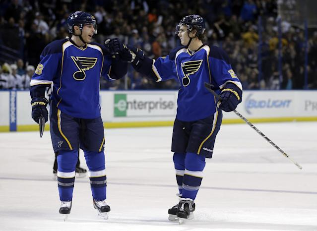 St. Louis Blues' Kevin Shattenkirk, right, is congratulated by Ian Cole after scoring during the second period of an NHL hockey game against the San Jose Sharks on Tuesday, Dec. 17, 2013, in St. Louis. (AP Photo/Jeff Roberson)