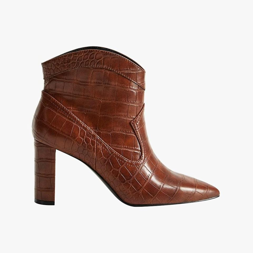 """$80, MANGO. <a href=""""https://shop.mango.com/us/women/shoes-boots-and-booties/pointed-heel-ankle-boot_77085932.html"""" rel=""""nofollow noopener"""" target=""""_blank"""" data-ylk=""""slk:Get it now!"""" class=""""link rapid-noclick-resp"""">Get it now!</a>"""