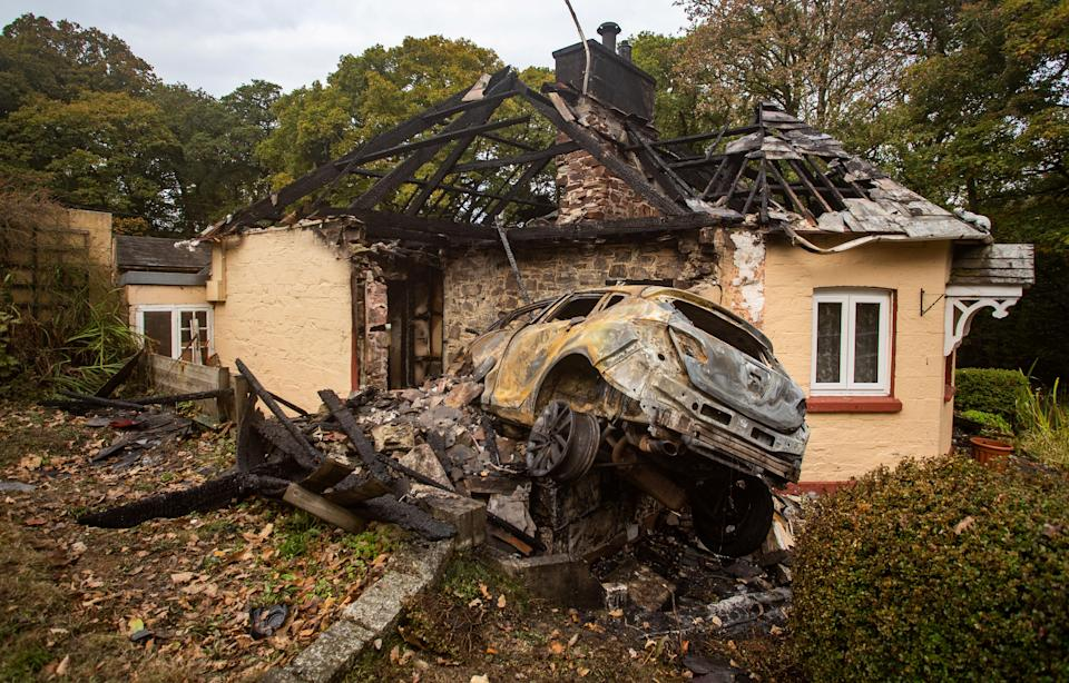 A driver has been arrested after car crashed into a house on the A38 in Cornwall. 19th October 2020  See SWNS story SWPLcrash. This dramatic picture shows the damage caused after a car crashed into a house before bursting into flames. The motorist ploughed into the home on the A38 causing both the property and car to catch fire. The roof was burned away, leaving charred beams and smoke damaged walls. The trapped driver was taken to Derriford Hospital in Plymouth, Devon, following the crash in Bodmin, Cornwall on Sunday at around 7.30pm.See SWNS story SWPLcrash. This dramatic picture shows the damage caused after a car crashed into a house before bursting into flames. The motorist ploughed into the home on the A38 causing both the property and car to catch fire. The roof was burned away, leaving charred beams and smoke damaged walls. The trapped driver was taken to Derriford Hospital in Plymouth, Devon, following the crash in Bodmin, Cornwall on Sunday at around 7.30pm.