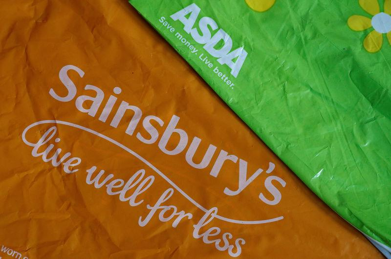 Shopping bags from Asda and Sainsbury's are seen in Manchester.