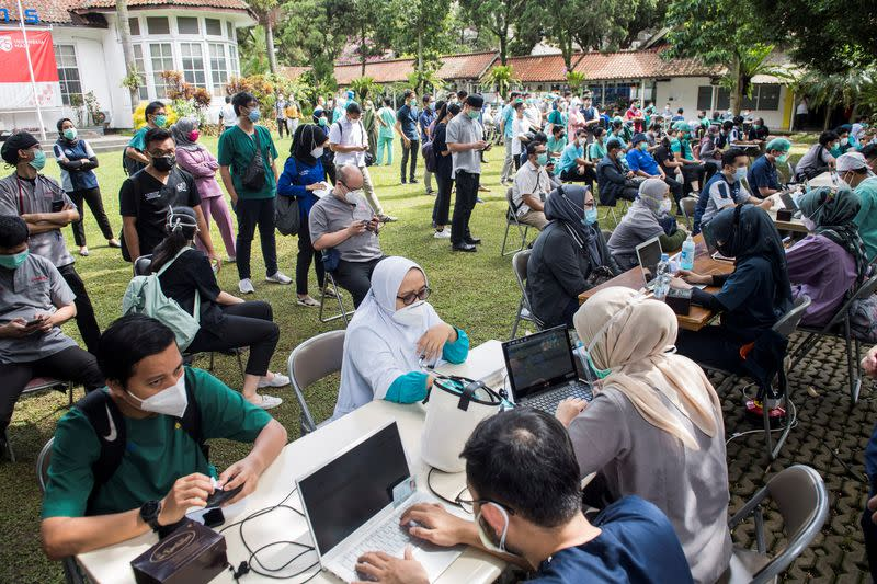 Indonesian healthcare workers are seen during verification and health screening before receiving Sinovac's vaccine for the coronavirus disease (COVID-19) at a hospital in Bandung