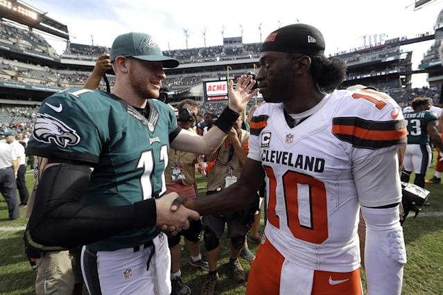 Carson Wentz, left, outplayed Robert Griffin III on Sunday (AP).