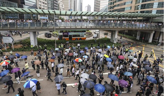 Protesters rally in Central during their lunch breaks. Photo: May Tse